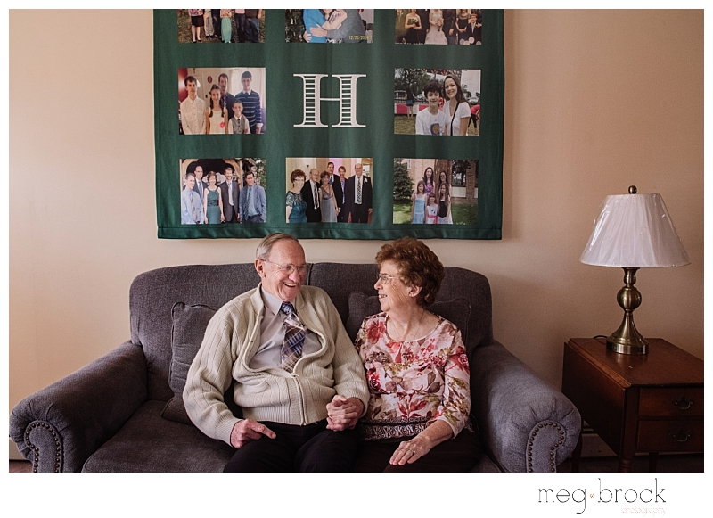 Couple married almost 60 years sits in their home of 60 years portrait session.