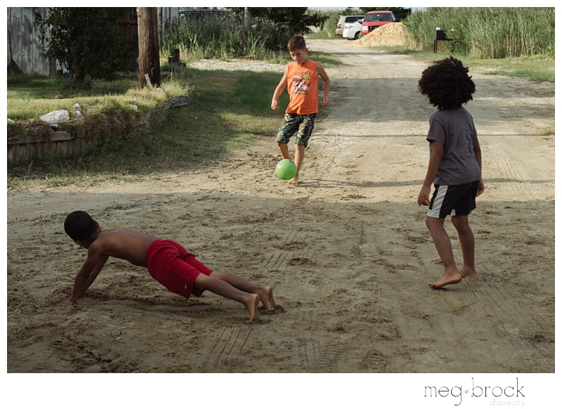 Kids play soccer in the sand during a New Jersey wedding.