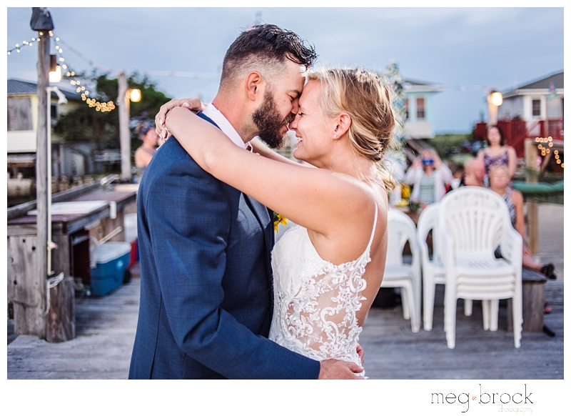 A bride and groom share a special moment during their first dance on dock at their elopement and small wedding.
